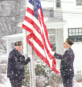 Corinth American Legion Post 533 members Edwin Eggleston, left, and Robert Patrenets raise a flag in honor of deceased veteran Clifford Palmateer of Galway. The flag, which has flown over the U.S. Capitol, will fly for one month at the Saratoga County Board of Supervisors building and then be given to the Palmateer family. Ed Burke 2/23/10