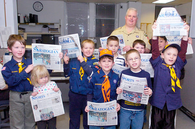 Troop Den 1 Pack 13 of Schuylerville visited the Saratogian to earn their communication badge Monday evening. Photo Erica Miller 2/22/10 fea_TroopVisit