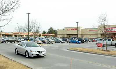Cars fill the parking lots in Wilton at their shopping plazas, Saratoga County's sales tax is down 8.3% excluding Saratoga Springs City. Photo Erica Miller 2/22/10 news_SalesTax3_Tues