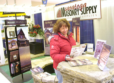 Sandra Lacy looks at a brochure at the Saratoga Masonry Supply booth Friday during opening night of the Saratoga Springs Rotary Club Home and Garden Show at the city center. Ed Burke  2/25/11