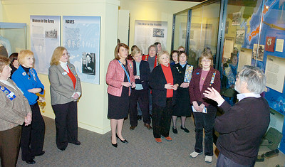 Michael Aikey, the Director of the New York State Military Museum leads a tour Saturday for board members of the New York State chapter of the Daughters of the American Revolution. State Regent Denise VanBuren is center with sash. Ed Burke 2/26/11