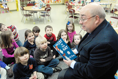 Retired principle of Saratoga Springs High School Frank Crowley reads to kindergartner students in Laurie Walsh's classroom as he will temporarily fill in as assistant principal as Tina Davis became the principal of Greenfield Elementary. Photo Erica Miller 2/28/11 news_FrankCrowley_Tues