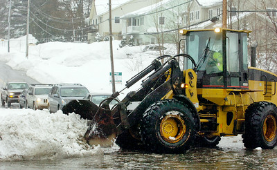 Saratoga Springs DPW on scene at East Ave and Excelsior Ave clearing  snow where the streets intersection has flooded to about a foot of water, as rain hits Saratoga area melting snow and flooding streets and streams.  Photo Erica Miller 2/28/11 news_Flooding3_Tues