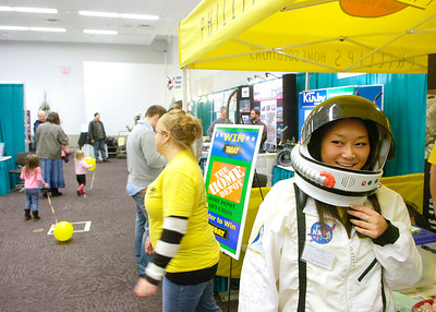 Dressed as an astronaut to promote insulation, Sue Bye works the Phillips Home Solutions booth Friday at the Saratoga Springs Rotary Club's 2011 Home and Garden Show at the City Center. Ed Burke 2/25/11