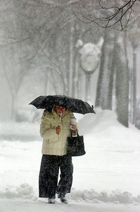 A women makes her way down Broadway with an umbrella as snow swiftly covers the sidewalks as Saratoga is under a winter storm warning in effect till Friday evening. Photo Erica Miller 2/25/11 news_SnowStorm2_Sat