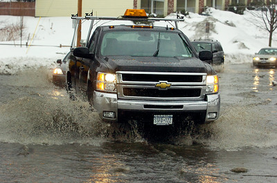 A truck drives through the intersection of East Avenue and Excelsior Avenue as rain hits Saratoga area melting snow and flooding streets and streams.  Photo Erica Miller 2/28/11 news_Flooding1_Tues