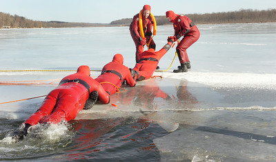 Quaker Springs Volunteer Fire Department geared up in waterproof jumpsuits in water rescue practices and training on the Saratoga Lake early Saturday morning. Photo Erica Miller 1/30/10 news_WaterRescue2_Sun