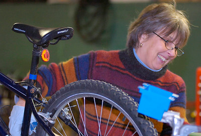 Joanne Klepetar help refurbish donated bikes Saturday in the basement of St. Peter's Church. The program provides bicycles to individuals in need of basic transportation and is run by the Saratoga Healthy Transportation Network and Saratoga County EOC. Ed Burke 1/30/10