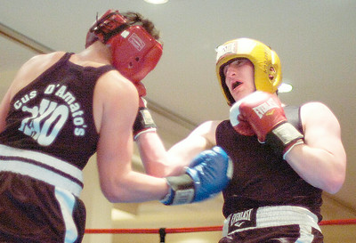 Saratoga's Jason Trembley connects with a right  during his bout against Catskill's Vic Kokonis during Friday's card at the Holiday Inn. Ed Burke 1/29/10