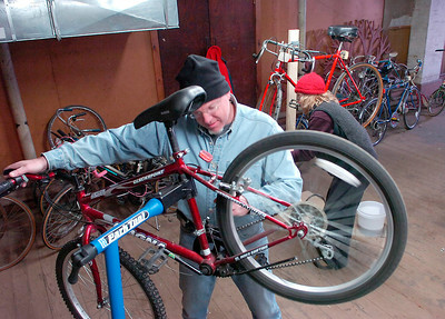 David DeLozier and Johanna Garrison help refurbish donated bikes Saturday in the basement of St. Peter's Church. The program provides bicycles to individuals in need of basic transportation and is run by the Saratoga Healthy Transportation Network and Saratoga County EOC. Ed Burke 1/30/10