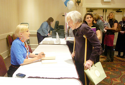 Mika Brzezinski chats with Elizabeth Feuerstein of East Galway during a booksigning prior to speaking at Saturday's Soroptimist Cabin Fever luncheon at the Holiday Inn. Brzezinski signed copies of her book All Things at Once. Ed Burke 1/29/11