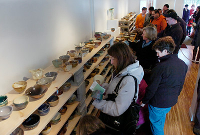 People look for the  perfect bowl Saturday at the first annual CHILI BOWL at Saratoga Clay Arts Center on Hayes Road in the town of Saratoga. After paying a donation people were able select one before dining on a selection of chilis created by local chefs. Over 500 bowls were created  by local artists for the event and money raised benefitted the Schuylerville Area Food and Emergency Relief Fund and the food pantry at Franklin Community Center in Saratoga Springs. Ed Burke 1/28/12