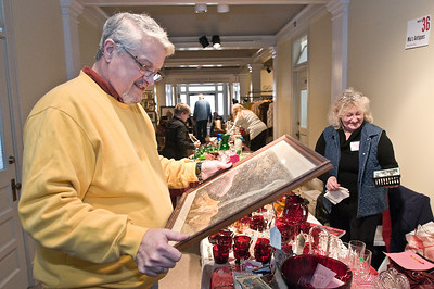 Joseph Mattie looks at a birds eye view lithograph of Troy, NY during the annual Winter Antique Show at the National Museum of Dance Sunday morning. Photo Eric Jenks 1/29/12