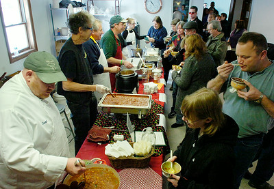 "Local ""celebrity"" chefs dish out chili during the first annual CHILI BOWL at Saratoga Clay Arts Center on Hayes Rd. in the town of Saratoga. Chefs front to back are: Jasper Alexander of Hatties, Rob Chrust of Amigo's Cantina, WNYT meterologist Bob Kovachick representing The Meat House, ""Big Mike"" McLoughlin sponsored by Curtis Lumber and Byron's Village Market, and Brenda Pfiitze with Tabby Fick of Fifty South. Ed Burke 1/28/12"