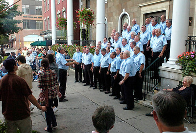 The Racing City Chorus performs Friday in front of the Rip Van Dam Plaza during the Hats Off Festival. Ed Burke 7/31/09