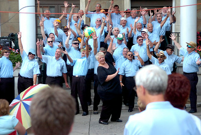 The Racing City Chorus ham it up as they sing Under The Boardwalk while performing in front of the Rip Van Dam Plaza during Friday's Hats Off Festival. Ed Burke 7/31/09