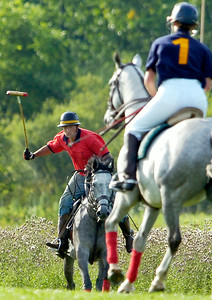 Will Orthwein and his wife Tabitha Orthwein, of Bloomfield Farm in Saratoga, due to cancelation of the Wednesday evening polo match exercised out some of the horses and hit the ball around on the Skidmore field, called stick and balling. Photo Erica Miller 7/22/09 news_PoloCancel2_Thurs