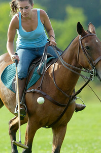 Rachel Czub, of Schaghticoke, due to cancelation of the Wednesday evening polo match exercised out some of the horses and hit the ball around on the Skidmore field, called stick and balling. Photo Erica Miller 7/22/09 news_PoloCancel1_Thurs