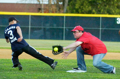 Philadelphia Orchestra's William Polk catches the ball as Jockey Alex Solis slides safely back to second base during their softball game benefiting the Permanently Disable Jockey's Fund at the East Side Rec Monday evening. Photo Erica Miller 8/1/11 news_Softball3_Tues