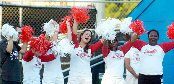Fans for the Jockey's team cheer during their softball game against the Philadelphia Orchestra benefiting the Permanently Disable Jockey's Fund at the East Side Rec Monday evening. Photo Erica Miller 8/1/11 news_Softball2_Tues