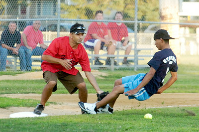 Jockey's teammate Irad Ortiz slides safely into third base as Philadelphia's  third baseman Rich Amoroso waits for a throw during their softball game benefiting the Permanently Disable Jockey's Fund at the East Side Rec Monday evening. Photo Erica Miller 8/1/11 news_Softball1_Tues