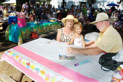 Jean and Tom Nevin of Fort Lauderdale, Florida relax at at track picnic table as they spend a day with their granddaughter Ava of South Glens Falls who was celebrating her fifth birthday. Ed Burke 7/30/11