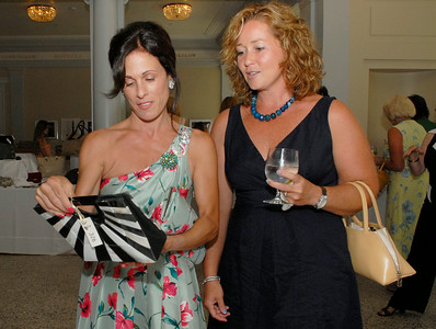Tania Luzzi (left) and Catalina Mueller glance over items at the auction as they attended Tuesday afternoon's Fashionable Fillies Luncheon at the National Museum of Dance and Hall of Fame for a benefit of the Museum and the Jockey Club Foundation. Photo Erica Miller 8/2/11 fea_FashionFillies2_Fri
