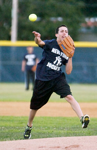 For team Jockey Irad Ortiz throws the ball to first base during their softball game benefiting the Permanently Disable Jockey's Fund at the East Side Rec Monday evening. Photo Erica Miller 8/1/11 news_Softball4_Tues