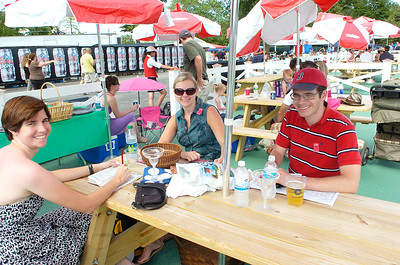 Laura Magno of Boston relaxes at a track picnic table Saturday with friends Christina Luke and Brian Lusignan of Cohoes. Ed Burke 7/30/11