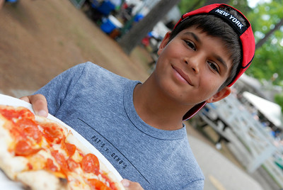 Visiting his grandparents in Saratoga Springs, Sam Aslansan, from Philadelphia, grabbed a hand made pizza to order on the backside at the Saratoga Race Course. Photo Erica Miller 7/30/12 news_FoodTrack4_Tues