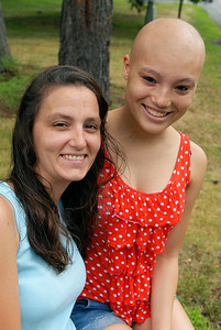 An avid runner and Senior at the Saratoga Springs High School Dionna Soto sits with her mother Amy Morine. Soto was recently diagnosed with cancer and undergoing chemo. They will be having an fundraising event for her to raise money. Photo Erica Miller 7/27/12 news_DionnaSoto2_Mon