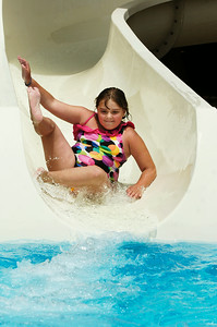 Ava James, 8 year-old, makes her way down a big water slide at the Saratoga Spa State Park Peerless Pool on Thursday afternoon. Photo Erica Miller 6/30/11 news_Peerless1_Fri