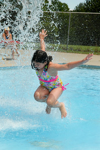 Emily Khan, 8 year-old, jumps up and down in one of the pools at the Saratoga Spa State Park Peerless Pool on Thursday afternoon. Photo Erica Miller 6/30/11 news_Peerless3_Fri