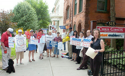 AFL-CIO organizer Amy Desjardins. right, speaks during a demonstration Wednesday at Congressman Chris Gibson's office on Broadway. Representatives of several groups gathered to oppose cuts to Medicaid, Medicare and Social Security. Ed Burke 6/29/11