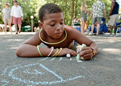 Dale McMillian draws on the sidewalk at SPAC Sunday afternoon while listening to the sounds of the 35th annual Jazz Festival. Photo Eric Jenks 7/1/12