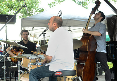 Guitarist Gilad Hekselman plays with his trio on SPAC's gazebo stage during Saturday's lineup at the Freihofer Saratoga Jazz Festival. Ed Burke 6/29/13