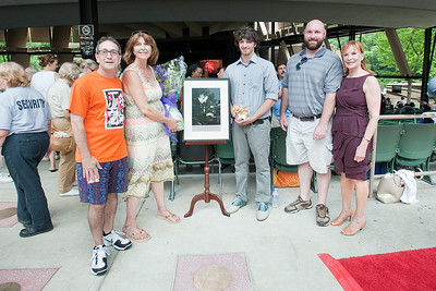 Dan Melnick (President of Absolutely Live Entertainment), Catherine Brubeck Yaghsizian, her son Daniel Yaghisizian, nephew TJ Snyder and SPAC President Marcia White pose for a photo behind the newly dedicated Star in the Walk of Fame with a portrait of Dave Brubeck Sunday afternoon during the Freihofer's Saratoga Jazz Festival. Photo Eric Jenks, 6/30/13