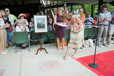 Catherine Brubeck Yaghsizian looks closely at the newly dedicated Star in the Walk of Fame in honor of her father Dave Brubeck Sunday afternoon during the Freihofer's Saratoga Jazz Festival. Photo Eric Jenks, 6/30/13