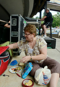 Longtime jazz festival attendee Anne Pawlik of Guilderland picnics with friends near the soundboard Saturday at SPAC. Ed Burke 6/29/13