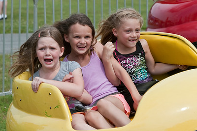 Hailey, Hannah, and Cheynne Stover go for a ride Sunday afternoon during the Family Fun day event at the Saratoga County Fairgrounds. Photo Eric Jenks 6/30/13
