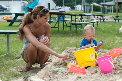 Bethany and her son Ethan Sherman play in the sand Sunday afternoon at the Saratoga County Fairgrounds during the Family Fun Day. Photo Eric Jenks 6/30/13