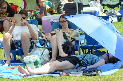 Jazz fans relax on the lawn while listening to Saturday's lineup at the jazz fest. Ed Burke 6/29/13