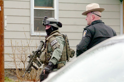 Warren County SWAT team prepares to surround the house of Aleksander Michaiski after he barricaded himself inside his home on Boylston Street in Glens Falls Tuesday. Photo Erica Miller 3/30/10 news_GFstandoff3_Wed