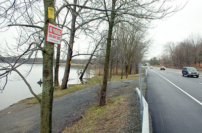 Cars fly down Route 9 in Round Lake at a speed of 55 mph Wednesday afternoon as two vechiles were parked on the side. Vechiles have been spotted unsafely parking on route 9 and launching their boats. Photo Erica Miller 3/31/10 news_RoundLake2_Thurs