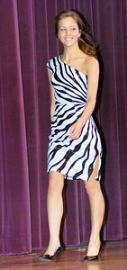 Samantha George poses during Ballston Spa High School's prom fashion show on Wednesday. All dresses were provided by Rockabella Boutique of Saratoga Springs. Ed Burke 3/31/10