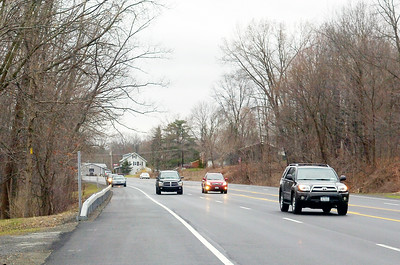 Cars fly down Route 9 in Round Lake at a speed of 55 mph Wednesday afternoon as two vechiles were parked on the side. Vechiles have been spotted unsafely parking on route 9 and launching their boats. Photo Erica Miller 3/31/10 news_RoundLake1_Thurs