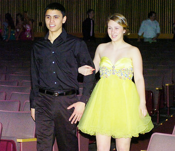 Matt Stewart escorts Annie Czelusniak during Ballston Spa High School's prom fashion show on Wednesday. All dresses provided by Rockabella Boutique of Saratoga Springs. Ed Burke 3/31/10