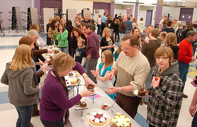 People enjoy sweets during intermission during Friday's Just Desserts cabaret fundraising show by the Ballston Spa High School Troupe. Ed Burke 3/4/11