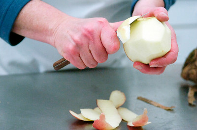Amy Kantor, of Saratoga Springs, peels an apple in preparation for making Charoset as part of the Seder Plate which is placed on all tables to represent the suffering and struggles they went through. Photo Erica Miller 3/29/10 news_ShaaraTFille1_Tues