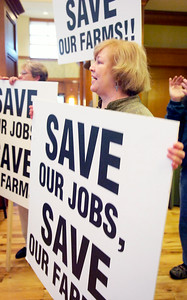 Karen Klotz, of Saratoga, holds a sign chanting at the Region call to action regarding the jeopardy of losing thoroughbred racing in Saratoga at the Hampton Inn and Suites on Lake Ave. Photo Erica Miller 3/30/10 news_RacingConf3_Wed